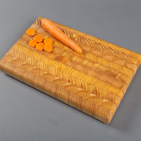 A handmade larch wood end grain cutting board - a classic design with a contemporary look.