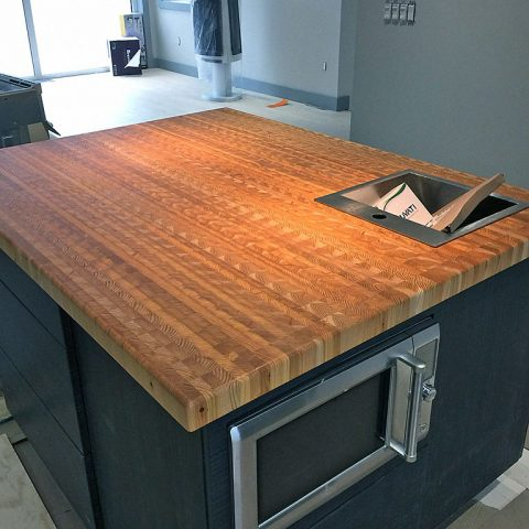 A large custom made island countertop .