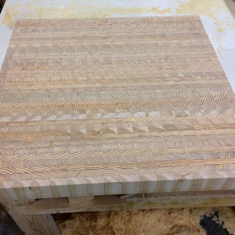 An end grain countertop being manufactured.