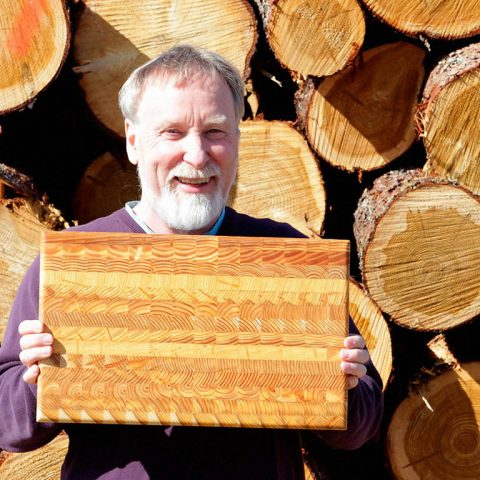 Another beautiful handcrafted Larch Wood cutting board.