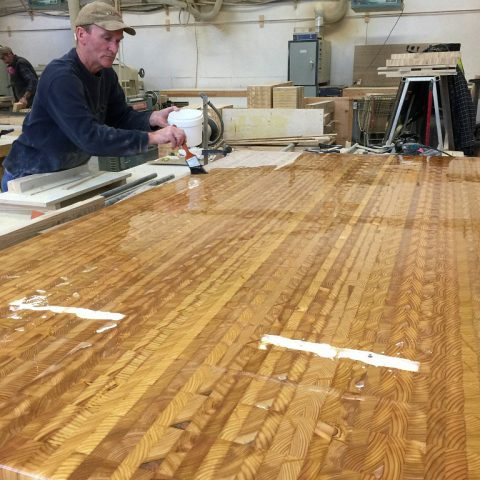Applying food safe mineral oils to a Larch Wood end grain countertop.