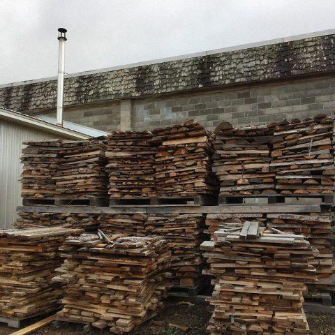 Using cutoff larch wood to heat business.